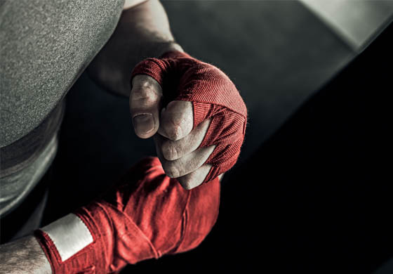 Man with hands taped to begin boxing