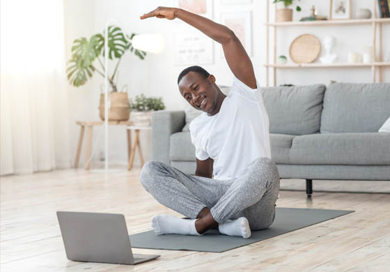 Man doing yoga in living room