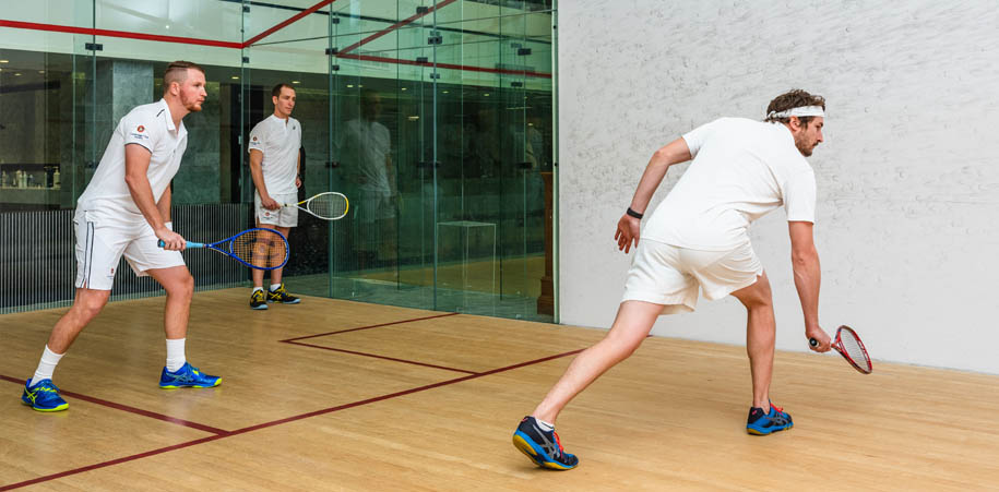 2 Members and our Squash Pro Tyler playing a game on one of our courts