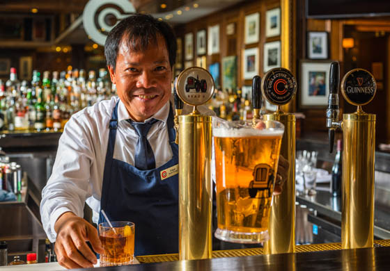 Edgar pouring a pitcher in the Oak Room