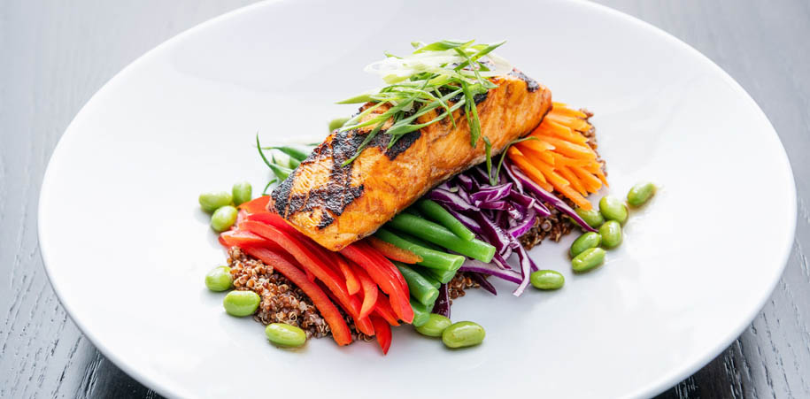 Salmon on a bed of vegetables