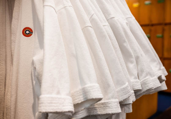 Cambridge Club robes hung up in the locker room